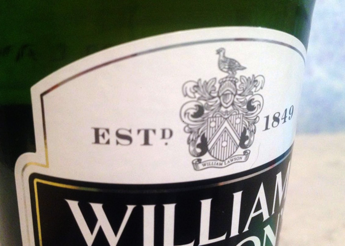 Герб на этикетке виски Виллиам Лоусен